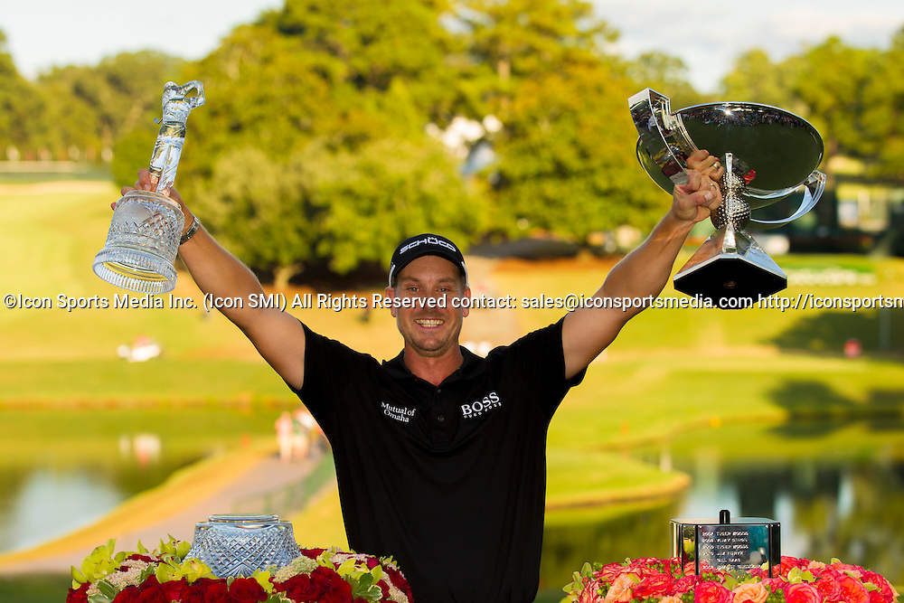 September 22, 2013: Henrik Stenson of Sweden holds the FedEx Cup and Tour Championship trophies after winning in the final round of the FedEx Cup - The Tour Championship at East Lake Golf Club in Atlanta, Georgia.