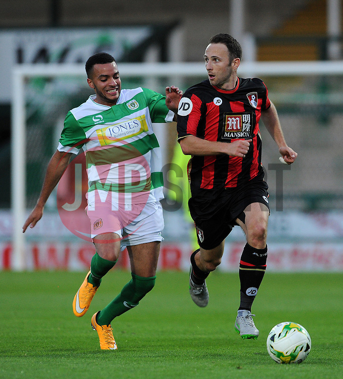 Bournemouth's Marc Pugh looks to break past Yeovil Town's Jordan Gibbons- Photo mandatory by-line: Harry Trump/JMP - Mobile: 07966 386802 - 28/07/15 - SPORT - FOOTBALL - Pre Season Fixture - Yeovil Town v Bournemouth - Huish Park, Yeovil, England.