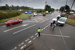 © Licensed to London News Pictures. 16/08/2019. Sulhamstead, UK. The scene at the junction of Ufton Lane (top), the A4 (C) and Lambdens Lane near Sulhamstead, Berkshire, where a police officer was killed while investigating a suspected burglary. Ten people have been arrested on suspicion of murder including a 13-year-old child. Photo credit: Peter Macdiarmid/LNP