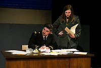 "Riley Alward Lt. Daniel Kaffee and Cici Zarella Lt. Jackie Ross during a scene at Guantanamo Base at dress rehearsal for ""A Few Good Men"" with Gilford High School Monday afternoon.  (Karen Bobotas/for the Laconia Daily Sun)"