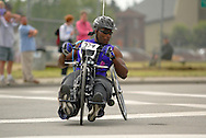 July 4th, 2006:  Anchorage, Alaska - James McGilberry (554), Army veteran from Banning, Calif, enters turn one of the 5k handcycle event at the 26th National Veterans Wheelchair Games.