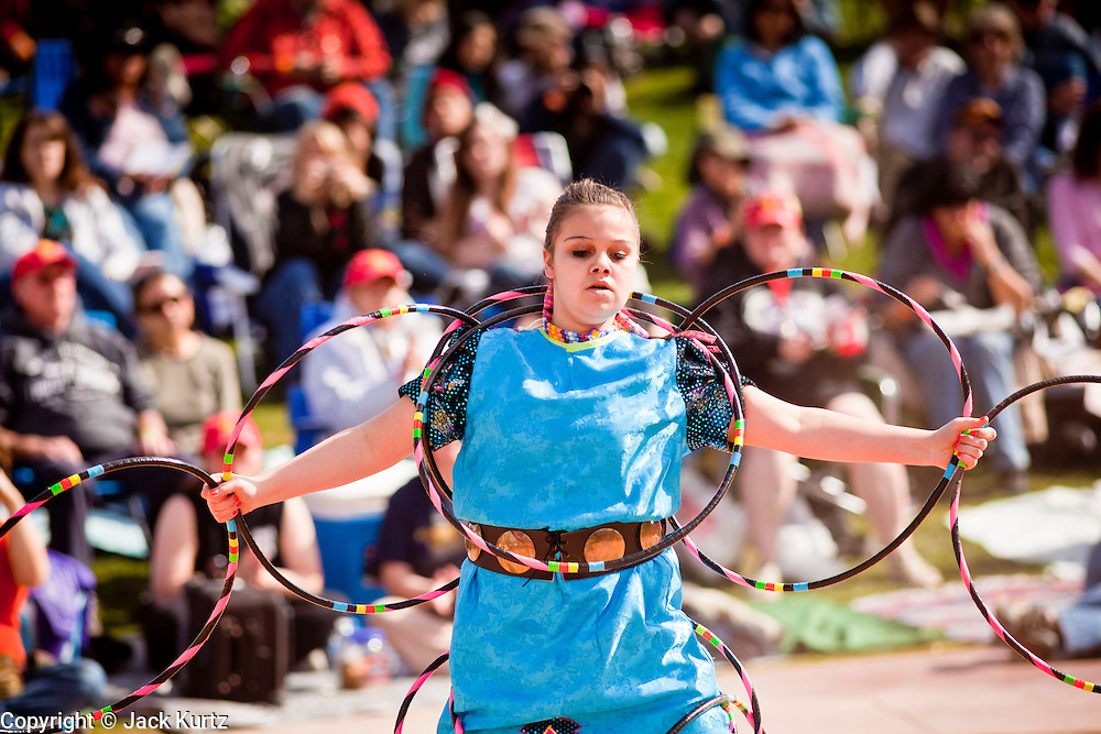 06 FEBRUARY 2011 - PHOENIX, AZ: CHELSEA WALKER, from the Grand Traverse Band Ottawa and Chippewa Indians, from Traverse City, MI, performs at the 21st Annual Heard Museum World Championship Hoop Dance Contest at the Heard Museum in Phoenix, AZ, Sunday, February 6. Hoop dancing has a long tradition among Native American peoples. The hoop or circle is symbolic to most Native people. It represents the Circle of Life and the continuous cycle of summer and winter, day and night, male and female. Some native people use hoop dancing as a part of healing ceremonies designed to restore balance and harmony in the world.      Photo by Jack Kurtz