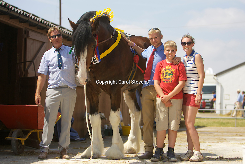 Paul &amp; Matthew Bedford with Verity Taylor and the Supreme Champion Shire  Metheringham Upton Hamlet<br /> f 2009  s  Moorfield Edward<br /> d  Kerrial Hester<br /> <br /> Winner Colt or Stallion 2 years old or over Class