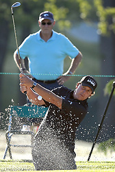 May 3, 2018 - Charlotte, North Carolina, U.S. - Phil Mickelson hits out of a sand trap along the 10th green during he first round of the Wells Fargo Championship at Quail Hollow Club in Charlotte. (Credit Image: © Jeff Siner/TNS via ZUMA Wire)