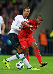 MOSCOW, RUSSIA - Tuesday, September 26, 2017: Liverpool's Joel Matip and FC Spartak Moscow's Fernando during the UEFA Champions League Group E match between Spartak Moscow and Liverpool at the Otkrytie Arena. (Pic by David Rawcliffe/Propaganda)