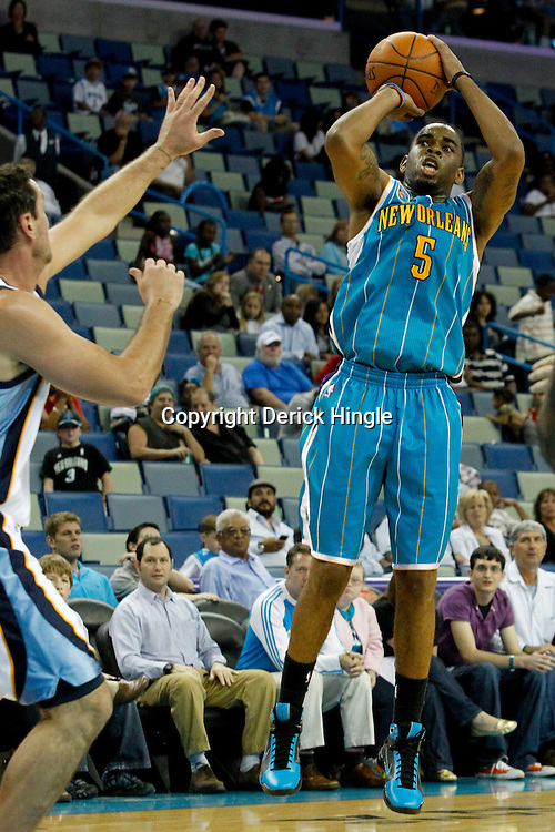 October 9, 2010; New Orleans, LA, USA; New Orleans Hornets guard Marcus Thornton (5) shoots against the Memphis Grizzlies during the second half of a preseason game at the New Orleans Arena.The Grizzlies defeated the Hornets 97-90. Mandatory Credit: Derick E. Hingle