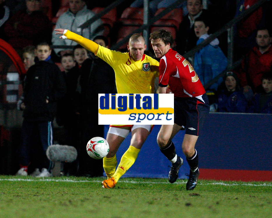 Photo: Richard Lane/Richard Lane Photography. <br />Wales v Norway. Nationwide International. 06/02/2008. <br />Wales' Freddy Eastwood is challenged by Norway's  Jarl-Andre Storbaek