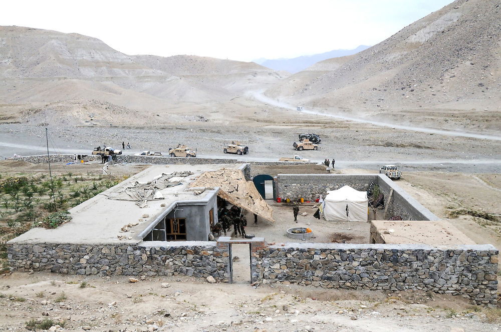 """US mentors living with Afghan National Army soldiers in a small """"Qalat"""" rented from a nearby village in Tagab Valley.  It is part of the counterinsurgency effort to connect with villagers, gather intelligence and provide local security.....Colonel Haynes said fixating solely on the enemy is a mistake.  His men are on the sharp end of the fight taking calculated risks as COIN doctrine prescribes.  The Marines' COIN strategies come from lessons learned by the French and British as well as their own history.  During the Vietnam War the Marines employed a similar COIN idea with some success known as """"Combined Action Programs (CAP's).""""  They lived in villages and fought alongside indigenous Vietnamese security forces.  Marine General Victor """"Brute"""" Krulak defended the program and waged his own internal policy war with Army General Westmoreland.  Krulak lost his battle with Westmoreland who preferred massive firepower and body counts - a strategy that wreaked havoc on the civilian population.  .."""