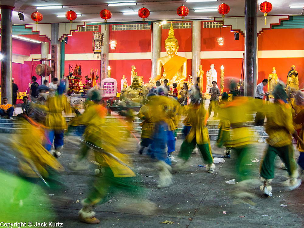 06 FEBRUARY 2014 - HAT YAI, SONGKHLA, THAILAND: Folk dancers perform in the Tong Sia Siang Tueng temple in Hat Yai. Hat Yai was originally settled by Chinese immigrants and still has a large ethnic Chinese population. Chinese holidays, especially Lunar New Year (Tet) and the Vegetarian Festival are important citywide holidays.     PHOTO BY JACK KURTZ