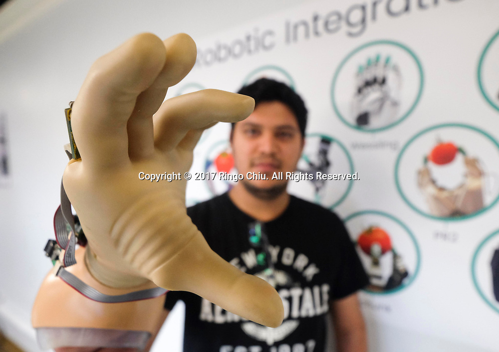 A staff of SynTouch demonstrates their robot fingers. (Photo by Ringo Chiu)<br /> <br /> Usage Notes: This content is intended for editorial use only. For other uses, additional clearances may be required.