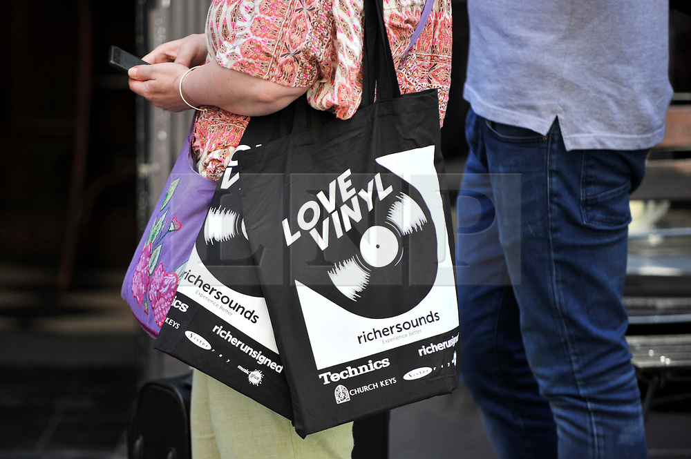 © Licensed to London News Pictures. 21/04/2018. LONDON, UK.  Analogue music fans queue to enter an independent record shop in Soho on the 11th annual Record Store Day.  Over 200 independent record shops all across the UK come together to celebrate the unique culture of vinyl music with special releases made exclusively for the day.  Photo credit: Stephen Chung/LNP