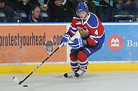 KELOWNA, CANADA - FEBRUARY 15:  Keegan Lowe #4 of the Edmonton OIl Kings skates with the puck against the Kelowna Rockets on February 15, 2012 at Prospera Place in Kelowna, British Columbia, Canada (Photo by Marissa Baecker/Getty Images) *** Local Caption *** Keegan Lowe;
