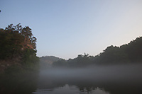 THE MOUNTAIN FORK RIVER NEAR BROKEN BOW OKLAHOMA SHROUDED IN FOG