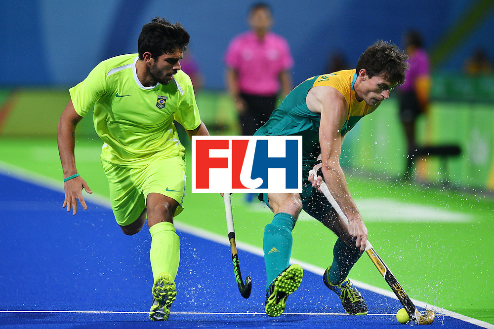 Brazil's Matheus Borges (L) and Australia's Fergus Kavanagh vie during the mens's field hockey Australia vs Brazil match of the Rio 2016 Olympics Games at the Olympic Hockey Centre in Rio de Janeiro on August, 12 2016. / AFP / Carl DE SOUZA        (Photo credit should read CARL DE SOUZA/AFP/Getty Images)