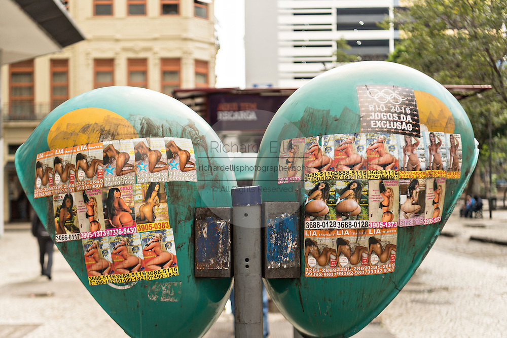 Oi telephone booths covered with ads for escort girls in the Centro neighborhood of Rio de Janeiro, Brazil.