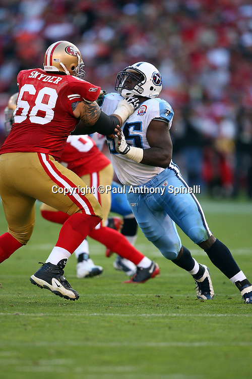 Tennessee Titans defensive end William Hayes (95) tries to work his way around a block and apparent throat hold by San Francisco 49ers offensive tackle Adam Snyder (68) during the NFL football game against the San Francisco 49ers, November 8, 2009 in San Francisco, California. The Titans won the game 34-27. (©Paul Anthony Spinelli)