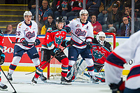 KELOWNA, CANADA - NOVEMBER 21:  Scott Mahovlich #25 and Liam Schioler #55 of the Regina Pats look for the pass as Lassi Thomson #2 tries to block the net of Roman Basran #30 of the Kelowna Rockets block on November 21, 2018 at Prospera Place in Kelowna, British Columbia, Canada.  (Photo by Marissa Baecker/Shoot the Breeze)