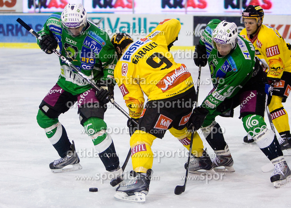 Yves Sarault between Bostjan Golicic  and Egon Muric of Olimpija during 52nd Round of EBEL league ice-hockey match between HDD Tilia Olimpija, Ljubljana and EV Vienna Capitals, on February 7, 2010 in Arena Tivoli, Ljubljana, Slovenia. Vienna defeated Olimpija 8-2. (Photo by Vid Ponikvar / Sportida)