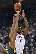 January 31, 2019; Oakland, CA, USA; Philadelphia 76ers center Joel Embiid (21) shoots the basketball against Golden State Warriors center Kevon Looney (5) during the second quarter at Oracle Arena.