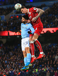 Aden Flint of Bristol City wins a header above Sergio Aguero of Manchester City - Mandatory by-line: Matt McNulty/JMP - 09/01/2018 - FOOTBALL - Etihad Stadium - Manchester, England - Manchester City v Bristol City - Carabao Cup Semi-Final First Leg