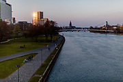 """Germany banned gatherings of more than 2 people called """"social distancing"""" because of the coronavirus. The shore of river Main in Frankfurt which is very empty on a - normally very busy - Thursday evening."""