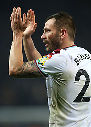 Burnley's Phil Bardsley applauds the traveling supporters after the game
