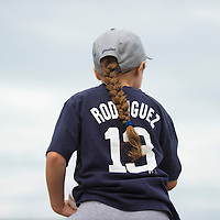 A young girl sits atop her father's shoulders in anticipation of an autograph from New York Yankees Third Baseman Alex Rodriguez during a minor league game for the AA Trenton Thunder in Trenton, NJ on August 3, 2013.  Rodriguez is facing a suspension by Major League Baseball for his alleged use of steroids with the Biogenesis clinic in Florida.