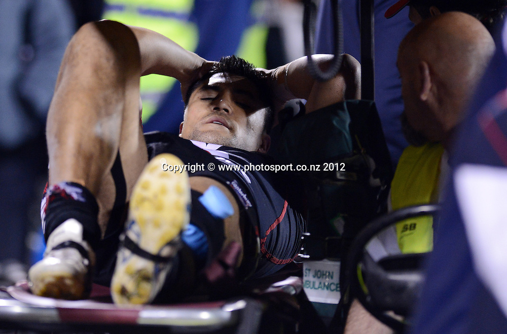 Jerome Ropati on a stretcher injured during the NRL Rugby League match, Vodafone Warriors v Sydney Roosters at Mt Smart Stadium, Auckland, New Zealand on Saturday 12 May 2012. Photo: Andrew Cornaga/photosport.co.nz