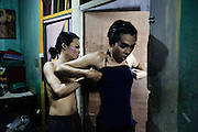 JAKARTA, INDONESIA, MARCH 2013: Selvie helps her friend dressing up for the night.