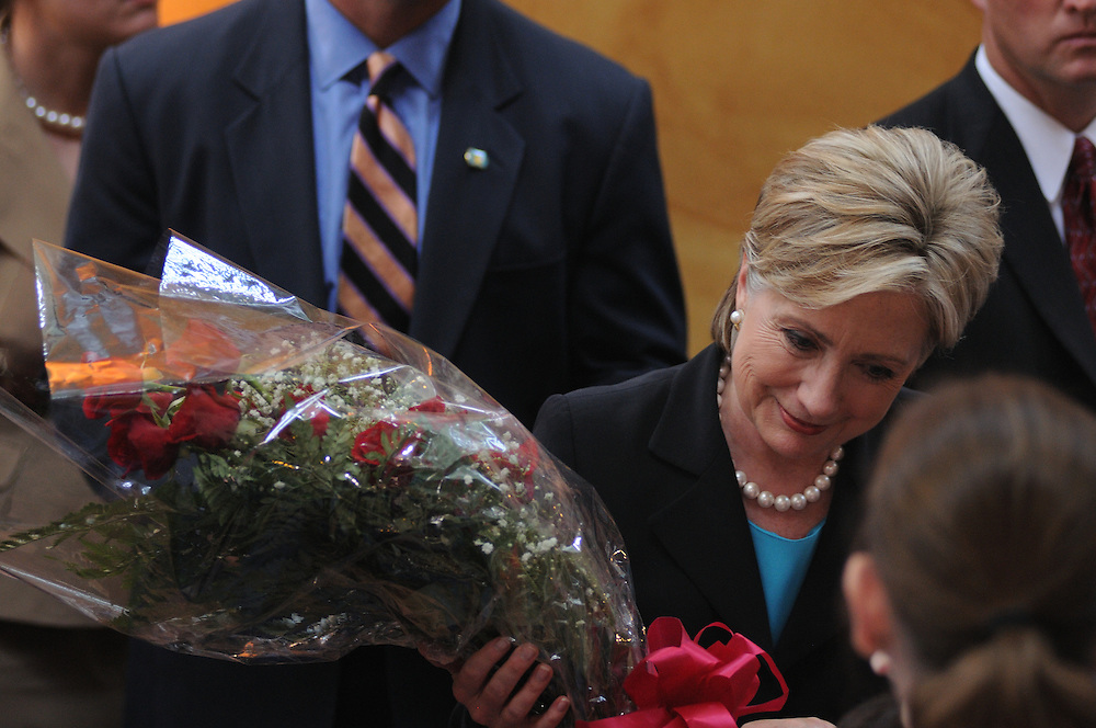 DISTRICT OF COLUMBIA - June 7, 2008:  U.S. Senator Hillary Clinton works the rope line and receives a bouquet of roses from a campaign supporter at the conclusion of announcing the end of her presidential bid for the White House and for her endorsement and support of presumptive democratic nominee for president, Sen. Barack Obama on Saturday at the National Building Museum in Washington, DC.