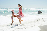 Mother and Daughter Paddling on Beach