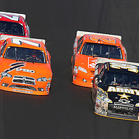 Sprint Cup Series driver Ryan Newman (39), Sprint Cup Series driver Joey Logano (20), Sprint Cup Series driver Robby Gordon (7) and rece winner Trevor Bayne (21) race during the Daytona 500 at Daytona International Speedway on February 20, 2011 in Daytona Beach, Florida. (AP Photo/Alex Menendez)