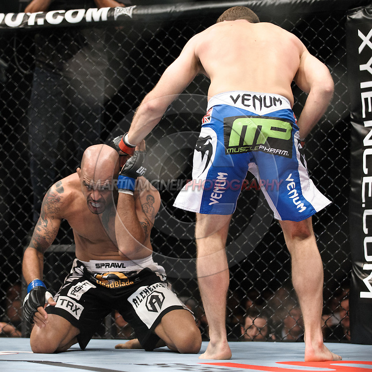 "SYDNEY, AUSTRALIA, FEBRUARY 27, 2011: Jorge Rivera (left) covers up from a punch thrown by Michael Bisping during ""UFC 127: Penn vs. Fitch"" inside Acer Arena in Sydney, Australia on February 27, 2011."