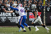Oakland Raiders quarterback Derek Carr (4) attempts to make a short pass to Oakland Raiders wide receiver Seth Roberts (10) against the Buffalo Bills at Oakland Coliseum in Oakland, Calif., on December 4, 2016. (Stan Olszewski/Special to S.F. Examiner)