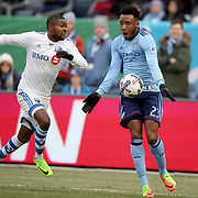 NEW YORK, NEW YORK - March 18:  Rodney Wallace #23 of New York City FC is challenged by Chris Duvall #18 of Montreal Impact during the New York City FC Vs Montreal Impact regular season MLS game at Yankee Stadium on March 18, 2017 in New York City. (Photo by Tim Clayton/Corbis via Getty Images)