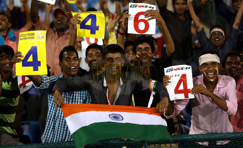 Fans enjoys  during match 3 of the Oppo Champions League Twenty20 between the Cape Cobras and the Northern Knights held at the Chhattisgarh International Cricket Stadium, Raipur, India on the 19th September 2014<br /> <br /> Photo by:  Sandeep Shetty / Sportzpics/ CLT20<br /> <br /> <br /> Image use is subject to the terms and conditions as laid out by the BCCI/ CLT20.  The terms and conditions can be downloaded here:<br /> <br /> http://sportzpics.photoshelter.com/gallery/CLT20-Image-Terms-and-Conditions-2014/G0000IfNJn535VPU/C0000QhhKadWcjYs