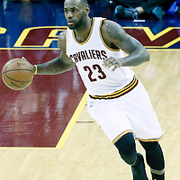 08 June 2016: Cleveland Cavaliers forward LeBron James (23) brings the ball up court during the Cleveland Cavaliers 120-90 victory over the Golden State Warriors, during Game Three of the 2016 NBA Finals at the Quicken Loans Arena, Cleveland, Ohio, USA.