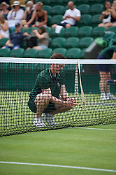 LONDON, ENGLAND - Saturday, July 6, 2019: Ground staff put up the net during the Gentlemen's Doubles second round match on Day Six of The Championships Wimbledon 2019 at the All England Lawn Tennis and Croquet Club. (Pic by Kirsten Holst/Propaganda)