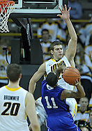December 17, 2011: Iowa Hawkeyes guard/forward Eric May (25) tries to block a shot by Drake Bulldogs guard Karl Madison (11) during the the NCAA basketball game between the Drake Bulldogs and the Iowa Hawkeyes at Carver-Hawkeye Arena in Iowa City, Iowa on Saturday, December 17, 2011. Iowa defeated Drake 82-68.