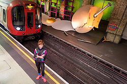 "© Licensed to London News Pictures. 07/06/2018. LONDON, UK.  British artist Heather Phillipson poses against her new work ""my name is lettie eggyscrub"", a major commission for Art on the Underground.  The installation fills the 80m platform at Gloucester Road Underground station.  Photo credit: Stephen Chung/LNP"