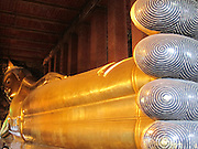 Reclining Buddha statue at Wat Pho temple in Bangkok, Thailand. Head to toes 150 feet (46 meters) long!