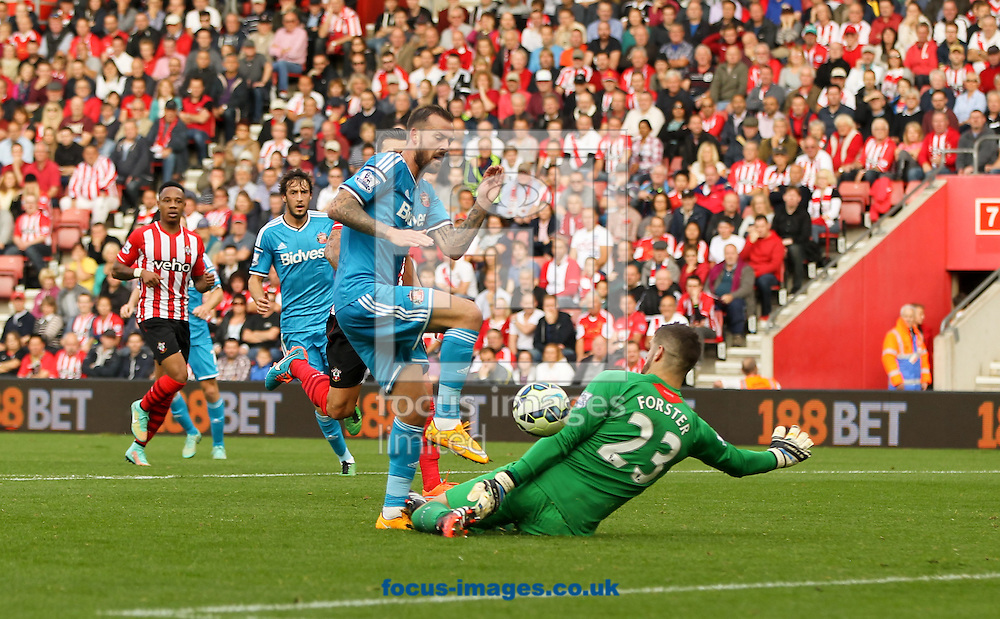 Fraser Forster of Southampton tackles Steven Fletcher of Sunderland during the Barclays Premier League match at the St Mary's Stadium, Southampton<br /> Picture by Tom Smith/Focus Images Ltd 07545141164<br /> 18/10/2014
