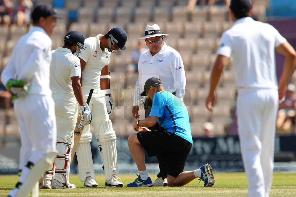 Pankaj Singh of India has some running repairs done to his pads during day four of the third Investec Test Match between England and India held at The Ageas Bowl cricket ground in Southampton, England on the 30th July 2014<br /> <br /> Photo by Ron Gaunt / SPORTZPICS/ BCCI