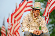 Mike Ford, a bareback rider from Grant Michigan, waits for the start of the Jefferson County Rodeo.