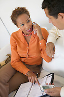 Businesswoman on Cell Phone Working With Businessman