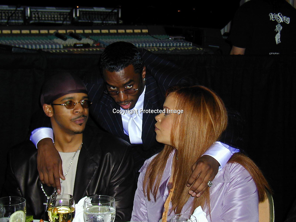 Puff Daddy, Faith Evans and friend<br />