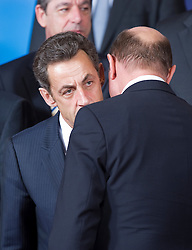 Nicolas Sarkozy, France's president, left, speaks with Donald Tusk, Poland's prime minister, during the European Summit, in Brussels, on Thursday, March 25, 2010. (Photo © Jock Fistick)