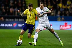 November 20, 2018 - Stockholm, Sweden - Victor Lindelof (L) of Sweden and Artem Dzyuba of Russia vie for the ball during the UEFA Nations League B Group 2 match between Sweden and Russia on November 20, 2018 at Friends Arena in Stockholm, Sweden. (Credit Image: © Mike Kireev/NurPhoto via ZUMA Press)