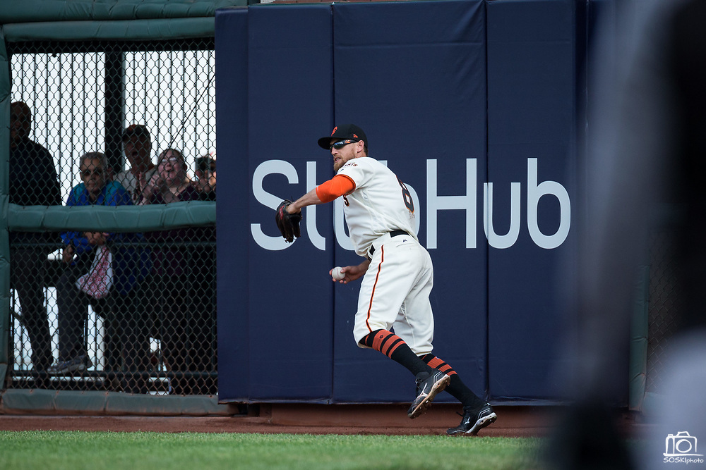 San Francisco Giants right fielder Hunter Pence (8) catches a Colorado Rockies fly ball at AT&T Park in San Francisco, California, on September 20, 2017. (Stan Olszewski/Special to S.F. Examiner)