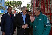 Manuel Jose, (c) the Portuguese Coach of the Egyptian football team Al-Ahly visits with a club security guards as he exits the Al-Ahly club stadium February 17, 2012  in Cairo, Egypt. Jose returned to Egypt Feb 16 after a 2 week break to resume his job of coach of Al-Ahly in the wake of post-football match violence February 2nd, 2012 that killed 74 and injured hundreds more in the Port Said, Egypt stadium.  (Photo by Scott Nelson)